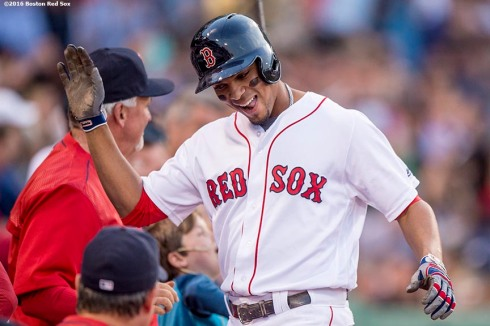 BOSTON, MA - MAY 12: Xander Bogaerts #2 of the Boston Red Sox reacts after hitting a two run home run during the first inning of a game against the Houston Astros on May 12, 2016 at Fenway Park in Boston, Massachusetts. (Photo by Billie Weiss/Boston Red Sox/Getty Images) *** Local Caption *** Xander Bogaerts