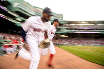 BOSTON, MA - MAY 12: Jackie Bradley Jr. #25 and Chris Young #30 of the Boston Red Sox run onto the field before a game against the Houston Astros on May 12, 2016 at Fenway Park in Boston, Massachusetts. (Photo by Billie Weiss/Boston Red Sox/Getty Images) *** Local Caption *** Jackie Bradley Jr.; Chris Young