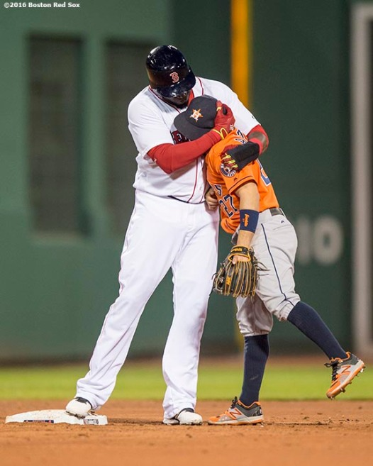 BOSTON, MA - MAY 12: David Ortiz #34 of the Boston Red Sox hugs Jose Altuve #27 of the Houston Astros after hitting a double during the third inning of a game on May 12, 2016 at Fenway Park in Boston, Massachusetts. (Photo by Billie Weiss/Boston Red Sox/Getty Images) *** Local Caption *** David Ortiz; Jose Altuve