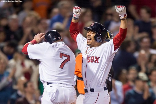 BOSTON, MA - MAY 12: Mookie Betts #50 of the Boston Red Sox reacts with Christian Vazquez #7 after hitting a three run home run during the sixth inning of a game against the Houston Astros on May 12, 2016 at Fenway Park in Boston, Massachusetts. (Photo by Billie Weiss/Boston Red Sox/Getty Images) *** Local Caption *** Mookie Betts; Christian Vazquez
