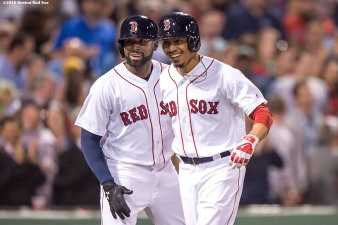 BOSTON, MA - MAY 12: Mookie Betts #50 of the Boston Red Sox reacts with Jackie Bradley Jr. #25 after hitting a three run home run during the sixth inning of a game against the Houston Astros on May 12, 2016 at Fenway Park in Boston, Massachusetts. (Photo by Billie Weiss/Boston Red Sox/Getty Images) *** Local Caption *** Mookie Betts; Jackie Bradley Jr.
