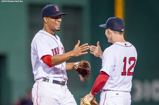 BOSTON, MA - MAY 12: Brock Holt #12 and Xander Bogaerts #2 of the Boston Red Sox celebrate a victory against the Houston Astros on May 12, 2016 at Fenway Park in Boston, Massachusetts. (Photo by Billie Weiss/Boston Red Sox/Getty Images) *** Local Caption *** Brock Holt; Xander Bogaerts