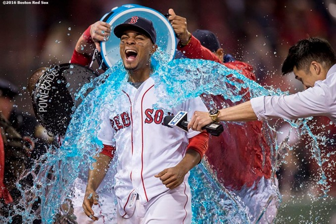 BOSTON, MA - MAY 12: Xander Bogaerts #2 of the Boston Red Sox reacts as a tub of Powerade is poured on him following a victory against the Houston Astros on May 12, 2016 at Fenway Park in Boston, Massachusetts. (Photo by Billie Weiss/Boston Red Sox/Getty Images) *** Local Caption *** Xander Bogaerts