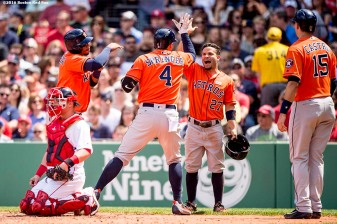 BOSTON, MA - MAY 14: George Springer #4 of the Houston Astros high fives Jose Altuve #27 after hitting a grand slam during the second inning of a game against the Houston Astros on May 14, 2016 at Fenway Park in Boston, Massachusetts. (Photo by Billie Weiss/Boston Red Sox/Getty Images) *** Local Caption *** George Springer; Jose Altuve