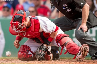 BOSTON, MA - MAY 14: Christian Vazquez #7 of the Boston Red Sox blocks a ball in the dirt during the eighth inning of a game against the Houston Astros on May 14, 2016 at Fenway Park in Boston, Massachusetts. (Photo by Billie Weiss/Boston Red Sox/Getty Images) *** Local Caption *** Christian Vazquez