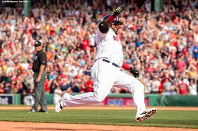 BOSTON, MA - MAY 14: David Ortiz #34 of the Boston Red Sox slides into third base as he hits a game tying RBI triple during the ninth inning of a game against the Houston Astros on May 14, 2016 at Fenway Park in Boston, Massachusetts. (Photo by Billie Weiss/Boston Red Sox/Getty Images) *** Local Caption *** David Ortiz