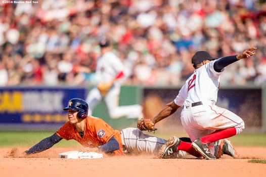 BOSTON, MA - MAY 14: Xander Bogaerts #2 of the Boston Red Sox tags out Carlos Correa #1 of the Houston Astros as he attempts to steal second base during the ninth inning of a game on May 14, 2016 at Fenway Park in Boston, Massachusetts. (Photo by Billie Weiss/Boston Red Sox/Getty Images) *** Local Caption *** Carlos Correa; Xander Bogaerts