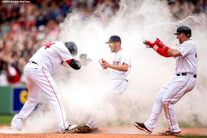 BOSTON, MA - MAY 14: David Ortiz #34 of the Boston Red Sox reacts as he is mobbed by Joe Kelly #18 and Travis Shaw #47 after hitting a game winning walk-off single during the eleventh inning of a game against the Houston Astros on May 14, 2016 at Fenway Park in Boston, Massachusetts. (Photo by Billie Weiss/Boston Red Sox/Getty Images) *** Local Caption *** David Ortiz; Travis Shaw; Joe Kelly