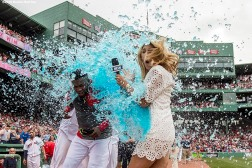BOSTON, MA - MAY 14: David Ortiz #34 of the Boston Red Sox reacts as he is given a Powerade bath alongside NESN reporter Guerin Austin after hitting a game winning walk-off single during the eleventh inning of a game against the Houston Astros on May 14, 2016 at Fenway Park in Boston, Massachusetts. (Photo by Billie Weiss/Boston Red Sox/Getty Images) *** Local Caption *** David Ortiz; Guerin Austin