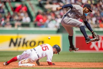 BOSTON, MA - MAY 15: Dustin Pedroia #15 of the Boston Red Sox slides to steal second base as Carlos Correa #1 of the Houston Astros allows the ball to pass during the first inning of a game against the Houston Astros on May 15, 2016 at Fenway Park in Boston, Massachusetts. (Photo by Billie Weiss/Boston Red Sox/Getty Images) *** Local Caption *** Dustin Pedroia; Carlos Correa