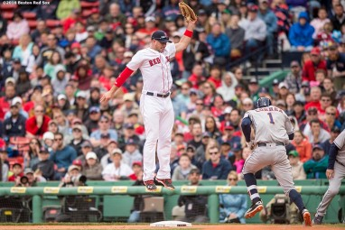 BOSTON, MA - MAY 15: Travis Shaw #47 of the Boston Red Sox catches a high throw from Josh Rutledge #32 as Carlos Correa #1 of the Houston Astros reaches first base during the sixth inning of a game on May 15, 2016 at Fenway Park in Boston, Massachusetts. (Photo by Billie Weiss/Boston Red Sox/Getty Images) *** Local Caption *** Travis Shaw; Carlos Correa