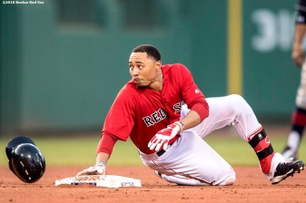 BOSTON, MA - MAY 20: Mookie Betts #50 of the Boston Red Sox slides as he steals second base during the first inning of a game against the Cleveland Indians on May 20, 2016 at Fenway Park in Boston, Massachusetts. (Photo by Billie Weiss/Boston Red Sox/Getty Images) *** Local Caption *** Mookie Betts