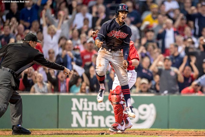BOSTON, MA - MAY 20: Francisco Lindor #12 of the Cleveland Indians reacts after avoiding the tag of Christian Vazquez #7 of the Boston Red Sox as he scores during the third inning of a game on May 20, 2016 at Fenway Park in Boston, Massachusetts. (Photo by Billie Weiss/Boston Red Sox/Getty Images) *** Local Caption *** Francisco Lindor; Christian Vazquez