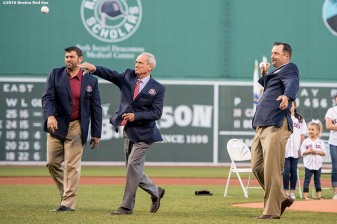 BOSTON, MA - MAY 20: Former Boston Red Sox catcher Jason Varitek, President & CEO Emeritus Larry Lucchino, and former pitcher Tim Wakefield throw out a ceremonial first pitch during a Red Sox Hall of Fame Class of 2016 ceremony before a game between the Boston Red Sox and the Cleveland Indians on May 20, 2016 at Fenway Park in Boston, Massachusetts. (Photo by Billie Weiss/Boston Red Sox/Getty Images) *** Local Caption *** Larry Lucchino; Jason Varitek; Tim Wakefield