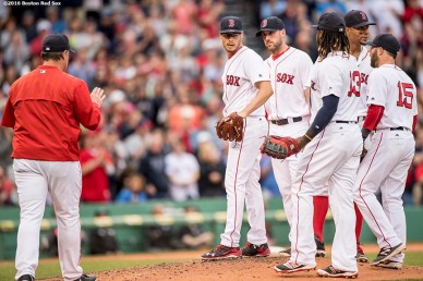 BOSTON, MA - MAY 21: Joe Kelly #56 reacts with teammates as he exits the game during the seventh inning of a game against the Cleveland Indians on May 21, 2016 at Fenway Park in Boston, Massachusetts, extending his hitting streak to 26 straight games. (Photo by Billie Weiss/Boston Red Sox/Getty Images) *** Local Caption *** Joe Kelly