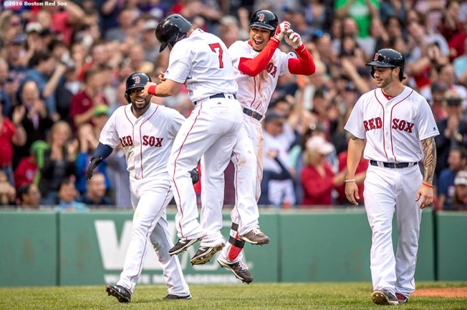BOSTON, MA - MAY 21: Mookie Betts #50 of the Boston Red Sox reacts with Jackie Bradley Jr. #25, Christian Vazquez #7, and Blake Swihart #23 after hitting a grand slam home run during the seventh inning of a game against the Cleveland Indians on May 21, 2016 at Fenway Park in Boston, Massachusetts. (Photo by Billie Weiss/Boston Red Sox/Getty Images) *** Local Caption *** Mookie Betts; Blake Swihart; Christian Vazquez; Jackie Bradley Jr.