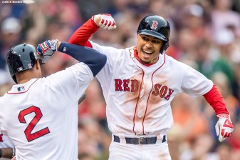 BOSTON, MA - MAY 21: Mookie Betts #50 of the Boston Red Sox reacts with Xander Bogaerts #2 after hitting a grand slam home run during the seventh inning of a game against the Cleveland Indians on May 21, 2016 at Fenway Park in Boston, Massachusetts. (Photo by Billie Weiss/Boston Red Sox/Getty Images) *** Local Caption *** Mookie Betts; Xander Bogaerts