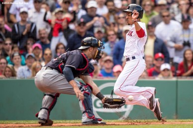 BOSTON, MA - MAY 22: Mookie Betts #50 of the Boston Red Sox evades the tag of Yan Gomes #10 of the Cleveland Indians as he scores during the sixth inning of a game on May 22, 2016 at Fenway Park in Boston, Massachusetts. (Photo by Billie Weiss/Boston Red Sox/Getty Images) *** Local Caption *** Mookie Betts: Yan Gomes