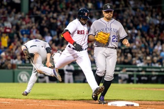 BOSTON, MA - MAY 24: Jackie Bradley Jr. #25 of the Boston Red Sox lunges to reach first base on an infield single as Jorge De La Rose #29 and Mark Reynolds #12 of the Colorado Rockies attempt to make the play during the third inning of a game on May 24, 2016 at Fenway Park in Boston, Massachusetts. (Photo by Billie Weiss/Boston Red Sox/Getty Images) *** Local Caption *** Jackie Bradley Jr.; Jorge De La Rosa; Mark Reynolds