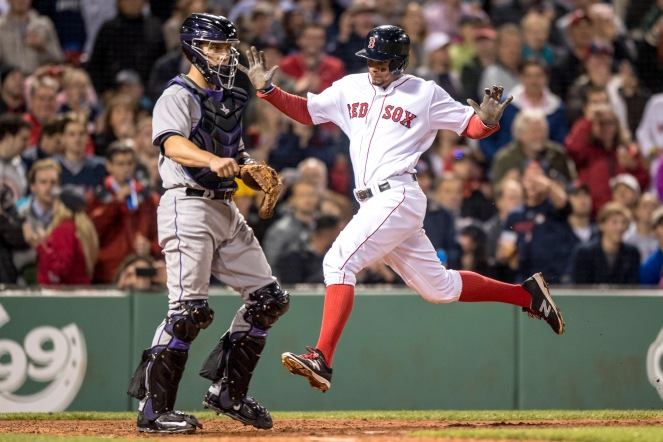 BOSTON, MA - MAY 24: Xander Bogaerts #2 of the Boston Red Sox scores as Dustin Garneau #13 of the Colorado Rockies looks on during the fourth inning of a game on May 24, 2016 at Fenway Park in Boston, Massachusetts. (Photo by Billie Weiss/Boston Red Sox/Getty Images) *** Local Caption *** Xander Bogaerts; Dustin Garneau