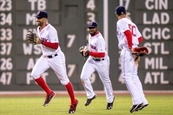 BOSTON, MA - MAY 24: Chris Young #30, Mookie Betts #50, and Jackie Bradley Jr. #25 of the Boston Red Sox celebrate a victory against the Colorado Rockies on May 24, 2016 at Fenway Park in Boston, Massachusetts. (Photo by Billie Weiss/Boston Red Sox/Getty Images) *** Local Caption *** Chris Young; Mookie Betts; Jackie Bradley Jr.