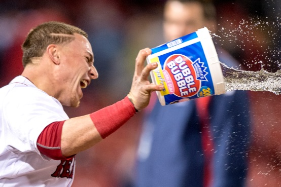 BOSTON, MA - MAY 24: Christian Vazquez #7 dumps a bucket of water on Xander Bogaerts of the Boston Red Sox following a game against the Colorado Rockies on May 24, 2016 at Fenway Park in Boston, Massachusetts. (Photo by Billie Weiss/Boston Red Sox/Getty Images) *** Local Caption *** Christian Vazquez