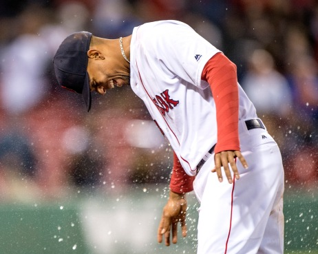 BOSTON, MA - MAY 24: Xander Bogaerts #2 of the Boston Red Sox reacts after having a bucket of water dumped on him after a game against the Colorado Rockies on May 24, 2016 at Fenway Park in Boston, Massachusetts. (Photo by Billie Weiss/Boston Red Sox/Getty Images) *** Local Caption *** Xander Bogaerts