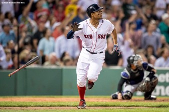 BOSTON, MA - MAY 25: Xander Bogaerts #2 of the Boston Red Sox hits a solo home run during the fourth inning of a game against the Colorado Rockies on May 25, 2016 at Fenway Park in Boston, Massachusetts. (Photo by Billie Weiss/Boston Red Sox/Getty Images) *** Local Caption *** Xander Bogaerts