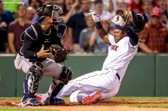 BOSTON, MA - MAY 25: Hanley Ramirez #13 of the Boston Red Sox slides and evades the tag of Tony Wolters #14 of the Colorado Rockies and scores during the fourth inning of a game against the Colorado Rockies on May 25, 2016 at Fenway Park in Boston, Massachusetts. (Photo by Billie Weiss/Boston Red Sox/Getty Images) *** Local Caption *** Hanley Ramirez; Tony Wolters