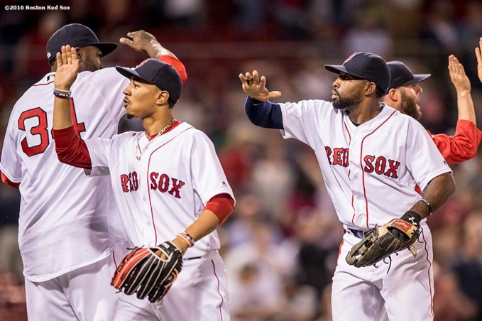 BOSTON, MA - MAY 25: Mookie Betts #50 and Jackie Bradley Jr. #25 of the Boston Red Sox high five teammates following a victory against the Colorado Rockies on May 25, 2016 at Fenway Park in Boston, Massachusetts. (Photo by Billie Weiss/Boston Red Sox/Getty Images) *** Local Caption *** Mookie Betts; Jackie Bradley Jr.