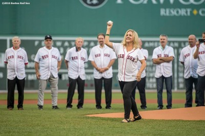 BOSTON, MA - MAY 25: Nancy Henderson, widow of former Boston Red Sox player Dave Henderson, throws out a ceremonial first pitch during a 1986 20-year team reunion before a game between the Boston Red Sox and the Colorado Rockies on May 25, 2016 at Fenway Park in Boston, Massachusetts. (Photo by Billie Weiss/Boston Red Sox/Getty Images) *** Local Caption *** Nancy Henderson