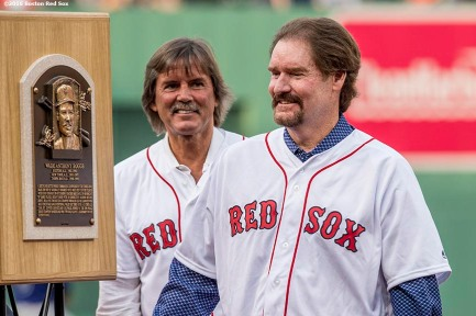 BOSTON, MA - MAY 26: Former Boston Red Sox third baseman Wade Boggs admires his Hall of Fame plaque alongside Dennis Eckersley as his number is retired during a special ceremony before a game between the Boston Red Sox and the Colorado Rockies on May 26, 2016 at Fenway Park in Boston, Massachusetts. (Photo by Billie Weiss/Boston Red Sox/Getty Images) *** Local Caption *** Wade Boggs; Dennis Eckersley