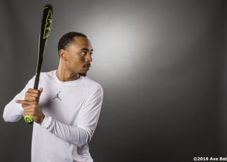 """Boston Red Sox outfielder Mookie Betts poses for a photograph for Axe Bat at Fenway Park in Boston, Massachusetts Wednesday, May 25, 2016."""