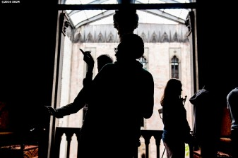 """Students attend an educational program in the Gothic Room at the Isabella Stewart Gardner Museum in Boston, Massachusetts Wednesday, June 2, 2016. """