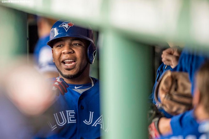BOSTON, MA - JUNE 3: Edwin Encarnacion #10 of the Toronto Blue Jays high fives teammates after hitting a two run home run during the first inning of a game against the Boston Red Sox on June 3, 2016 at Fenway Park in Boston, Massachusetts. (Photo by Billie Weiss/Boston Red Sox/Getty Images) *** Local Caption *** Edwin Encarnacion