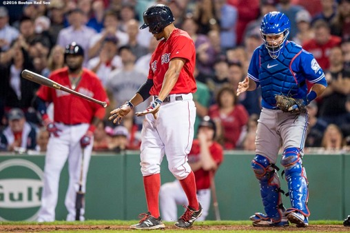 BOSTON, MA - JUNE 3: Xander Bogaerts #2 of the Boston Red Sox throws his bat after striking out to record the final out of the game as Josh Thole #22 of the Toronto Blue Jays reacts during a game on June 3, 2016 at Fenway Park in Boston, Massachusetts. (Photo by Billie Weiss/Boston Red Sox/Getty Images) *** Local Caption *** Xander Bogaerts; Josh Thole