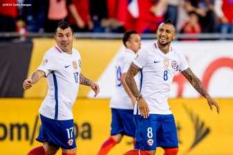 FOXBOROUGH, MASSACHUSETTS - JUNE 10: Arturo Vidal of Chile reacts with teammates after scoring a goal during a group D match between Chile and Bolivia at Gillette Stadium as part of Copa America Centenario US 2016 on June 10, 2016 in Foxborough, Massachusetts, US. (Photo by Billie Weiss/LatinContent/Getty Images) *** Local Caption *** Arturo Vidal