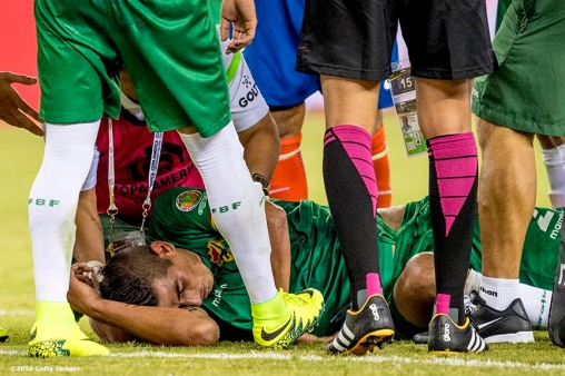 FOXBOROUGH, MASSACHUSETTS - JUNE 10: Ronald Eguino of Bolivia is injured during a group D match between Chile and Bolivia at Gillette Stadium as part of Copa America Centenario US 2016 on June 10, 2016 in Foxborough, Massachusetts, US. (Photo by Billie Weiss/LatinContent/Getty Images) *** Local Caption *** Ronald Eguino