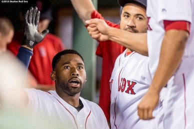 BOSTON, MA - JUNE 14: Jackie Bradley Jr. #25 of the Boston Red Sox high fives teammates after hitting a solo home run during the seventh inning of a game against the Baltimore Orioles on June 14, 2016 at Fenway Park in Boston, Massachusetts. (Photo by Billie Weiss/Boston Red Sox/Getty Images) *** Local Caption *** Jackie Bradley Jr.