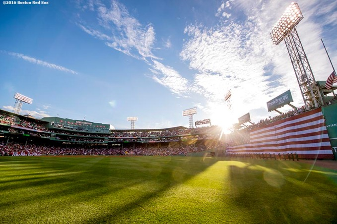 BOSTON, MA - JUNE 14: The American flag is dropped over the Green Monster in recognition of Flag Day before a game between the Boston Red Sox and the Baltimore Orioles on June 14, 2016 at Fenway Park in Boston, Massachusetts. (Photo by Billie Weiss/Boston Red Sox/Getty Images) *** Local Caption ***
