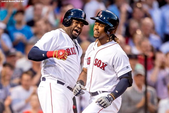BOSTON, MA - JUNE 15: Hanley Ramirez #13 high fives David Ortiz #34 of the Boston Red Sox after hitting a three run home run during the third inning of a game against the Baltimore Orioles on June 15, 2016 at Fenway Park in Boston, Massachusetts. (Photo by Billie Weiss/Boston Red Sox/Getty Images) *** Local Caption *** Hanley Ramirez; David Ortiz