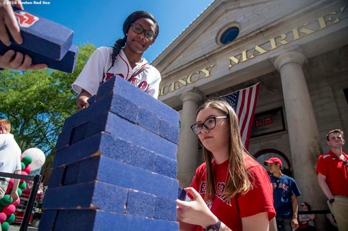 June 15, 2016, Boston, MA: Fans participate in Red Sox Jenga during the unveiling of the Red Sox Showcase Mobile Truck powered by T-Mobile at Faneuil Hall in Boston, Massachusetts Wednesday, June 15, 2016. (Photo by Billie Weiss/Boston Red Sox)