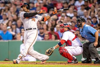 BOSTON, MA - JUNE 16: Adam Jones #10 of the Baltimore Orioles hits an RBI double during the fourth inning of a game against the Boston Red Sox on June 16, 2016 at Fenway Park in Boston, Massachusetts. (Photo by Billie Weiss/Boston Red Sox/Getty Images) *** Local Caption *** Adam Jones