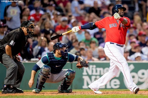 BOSTON, MA - JUNE 17: David Ortiz #34 of the Boston Red Sox hits a two-run home run during the fourth inning of a game against the Seattle Mariners on June 17, 2016 at Fenway Park in Boston, Massachusetts. It was the 521st home run of his career, moving him into a tie for 19th place on the all-time home run list. (Photo by Billie Weiss/Boston Red Sox/Getty Images) *** Local Caption *** David Ortiz