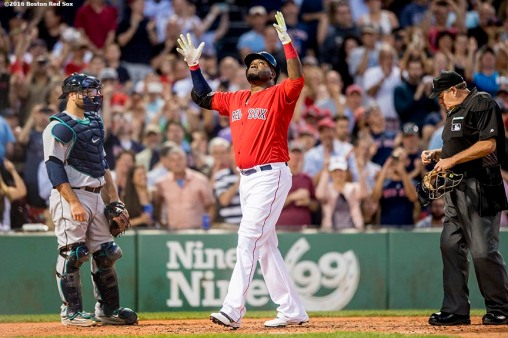 BOSTON, MA - JUNE 17: David Ortiz #34 of the Boston Red Sox reacts after hitting a two-run home run during the fourth inning of a game against the Seattle Mariners on June 17, 2016 at Fenway Park in Boston, Massachusetts. It was the 521st home run of his career, moving him into a tie for 19th place on the all-time home run list. (Photo by Billie Weiss/Boston Red Sox/Getty Images) *** Local Caption *** David Ortiz