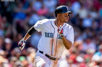 BOSTON, MA - JUNE 19: Xander Bogaerts #2 of the Boston Red Sox runs to first base after hitting single during the sixth inning of a game against the Seattle Mariners on June19, 2016 at Fenway Park in Boston, Massachusetts. It was his 100th hit of the season. (Photo by Billie Weiss/Boston Red Sox/Getty Images) *** Local Caption *** Xander Bgaerts