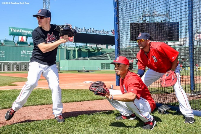 BOSTON, MA - JUNE 22: Deven Marrero #16, Brock Holt #12 and Mookie Betts #50 of the Boston Red Sox pretend to call balls and strikes during batting practice before a game against the Chicago White Sox on June 22, 2016 at Fenway Park in Boston, Massachusetts. (Photo by Billie Weiss/Boston Red Sox/Getty Images) *** Local Caption *** Mookie Betts; Brock Holt; Deven Marrero