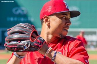 BOSTON, MA - JUNE 22: Mookie Betts #50 of the Boston Red Sox throws during batting practice before a game against the Chicago White Sox on June 22, 2016 at Fenway Park in Boston, Massachusetts. (Photo by Billie Weiss/Boston Red Sox/Getty Images) *** Local Caption *** Mookie Betts