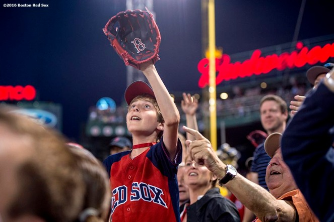 BOSTON, MA - JUNE 22: A young fan catches a foul ball during a game between the Boston Red Sox and the Chicago White Sox on June 22, 2016 at Fenway Park in Boston, Massachusetts. (Photo by Billie Weiss/Boston Red Sox/Getty Images) *** Local Caption ***