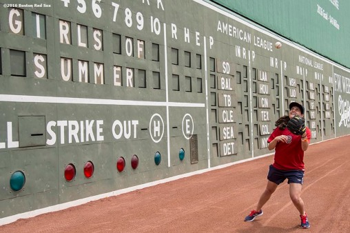 June 22, 2016, Boston, MA: A fan takes fly balls of the Green Monster during the Girls of Summer event at Fenway Park in Boston, Massachusetts Tuesday, June 22, 2016. (Photo by Billie Weiss/Boston Red Sox)